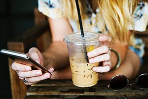 Texting with Iced Coffee